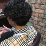 クルクルパーマから普通の髪型に